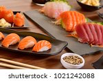 salmon nigiri sushi on black... | Shutterstock . vector #1021242088