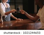 woman serving coffee over the... | Shutterstock . vector #1021244653