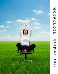 bright picture of young businesswoman practicing yoga on the meadow - stock photo