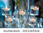 floating votive candles in... | Shutterstock . vector #1021265326