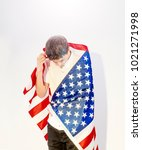 Small photo of Depressive teenager with the flag of the United States, despair concept
