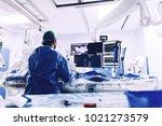 cardiologist doing catheter... | Shutterstock . vector #1021273579