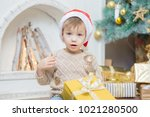 a little boy in a red cap sits... | Shutterstock . vector #1021280500