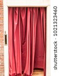 red curtain hung in a doorway | Shutterstock . vector #1021323460