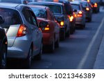 blurred busy road long line of... | Shutterstock . vector #1021346389