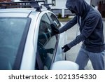 car thief  car theft | Shutterstock . vector #1021354330
