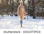 Young Caucasian Woman Walking...