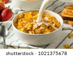 healthy corn flakes with milk... | Shutterstock . vector #1021375678