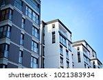 facade of a modern apartment... | Shutterstock . vector #1021383934