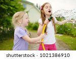 adorable little girls playing... | Shutterstock . vector #1021386910