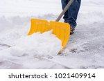 man shoveling snow in driveway... | Shutterstock . vector #1021409914