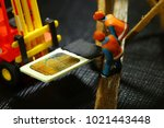 damaged sim card and miniature...   Shutterstock . vector #1021443448