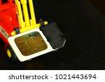 damaged sim card and miniature...   Shutterstock . vector #1021443694