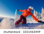 snowboarder on snowboard rides...   Shutterstock . vector #1021463449