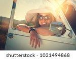 girl posing in a car in sunset... | Shutterstock . vector #1021494868