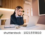 frustrated worried young woman... | Shutterstock . vector #1021555810