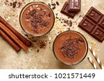 chocolate banana smoothie with... | Shutterstock . vector #1021571449