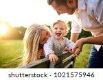 happy family in a park in... | Shutterstock . vector #1021575946