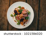 ros  duck breast with broccoli... | Shutterstock . vector #1021586020