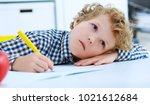 tired little boy sitting at the ... | Shutterstock . vector #1021612684