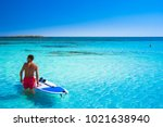 tropical sandy beach with... | Shutterstock . vector #1021638940