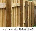 new perimeter wood fence | Shutterstock . vector #1021669663