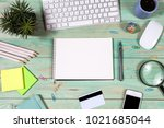 office desk table with laptop ... | Shutterstock . vector #1021685044