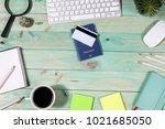 on the laptop desk foreign... | Shutterstock . vector #1021685050