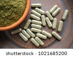 close up green capsules and... | Shutterstock . vector #1021685200