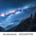 space with milky way  girl and... | Shutterstock . vector #1021695700