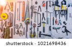 old tools hanging on wall in... | Shutterstock . vector #1021698436