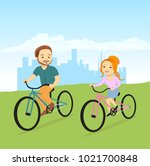 boy and girl riding bikes on a... | Shutterstock .eps vector #1021700848