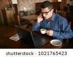 caucasian businessman using... | Shutterstock . vector #1021765423