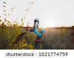 woman in turquoise hat standing ... | Shutterstock . vector #1021774759