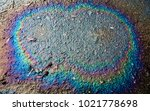 car oil and gas spot on the wet ... | Shutterstock . vector #1021778698