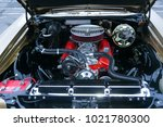 the engine of the old car  the... | Shutterstock . vector #1021780300
