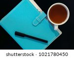 close up top view mint notebook ... | Shutterstock . vector #1021780450