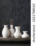 white ceramic vases on... | Shutterstock . vector #1021788010