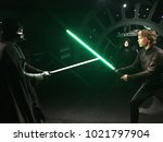 Small photo of London, Great Britain, England - 08/11/2017: Madame Tussaud Museum, wax figure of Darth Vader and Luke Skywalker in the reconstruction of the Star Wars set.