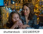 mother and daughter in the home ...   Shutterstock . vector #1021805929