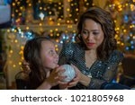 mother and daughter in the home ...   Shutterstock . vector #1021805968