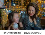 mother and daughter in the home ... | Shutterstock . vector #1021805980
