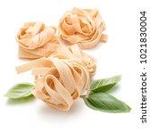 italian pasta fettuccine nest... | Shutterstock . vector #1021830004