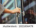 close up of woman unlocking... | Shutterstock . vector #1021836478