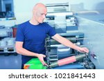 printer operator next to the... | Shutterstock . vector #1021841443
