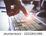 the man's hand touches the... | Shutterstock . vector #1021841488