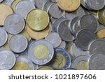 canadian coins in pile | Shutterstock . vector #1021897606