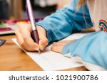 child doing homework. a young... | Shutterstock . vector #1021900786