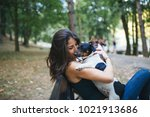Stock photo dog walker with dogs enjoying in park 1021913686