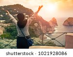 tourist woman standing on capri ... | Shutterstock . vector #1021928086